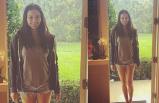 Yağmur yağıyordu, kapıdan Adriana girdi
