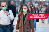 Corona virüs aşısı olan insanlar maske takmaya devam edecek mi?