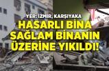İzmir'de hasarlı bina sağlam binanın üzerine çöktü!
