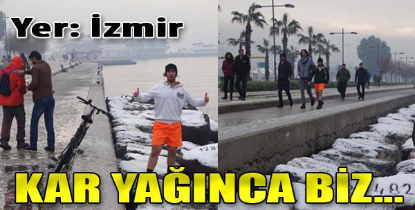 İzmir'de Karla Kaplı Sahilde Şortlu Gezinti