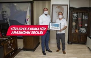Karikatürist Ömer Çam'dan, Başkan Gümrükçü'ye...