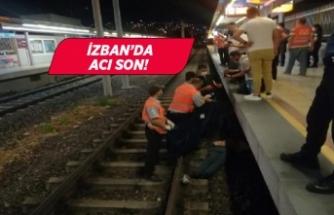İzmir'de İZBAN'da rayların altında kaldı!