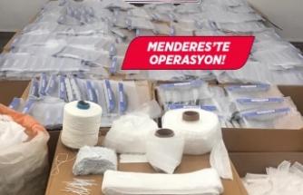 İzmir'de kaçak üretilen maske ve koruyucu siperliklere el kondu