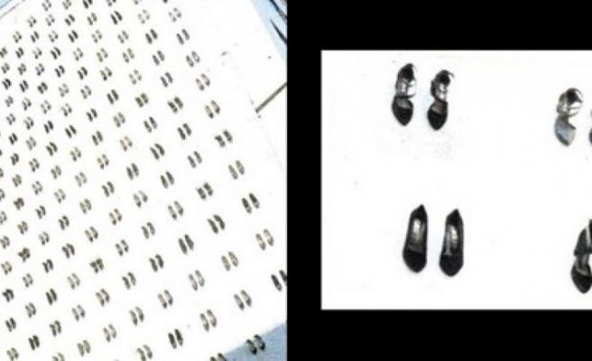 Kadın cinayetleri duvara yansıdı: 440 kadın ayakkabısı