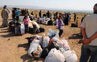 100 Bin Kişi Türkiye'ye Kaçıyor