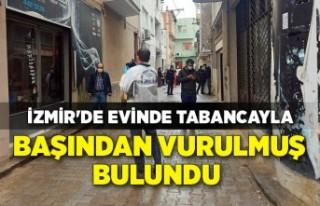 İzmir'de evinde tabancayla başından vurulmuş...