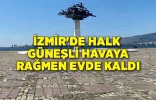 İzmir'de halk güneşli havaya rağmen evde...