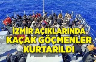 İzmir açıklarında 105 kaçak göçmen kurtarılırken,...