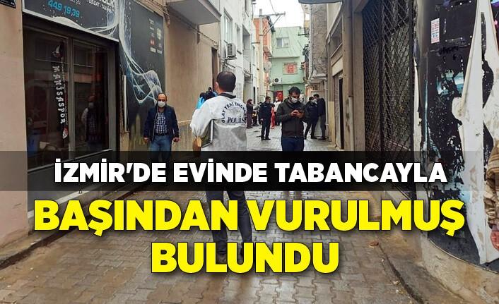 İzmir'de evinde tabancayla başından vurulmuş bulundu